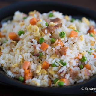 Bacon and Egg Fried Rice with Peas and Carrots.