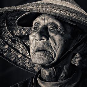 The Ferryman by Lucky E. Santoso - People Portraits of Men ( senior citizen )