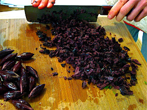 Photo: chopping pitted salted black olives