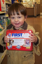 Photo: Mommy was looking at Bandaids, Crackers picked out this first aid kit - what the heck, we put it in the cart.