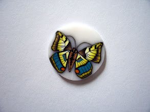 """Photo: Butterfly - 4, Colors: Turquoise, Green, Orange, Yellow, White, Black and more mixed multicolored Butterfly. Very detailed. $6.00 per inch long with a Diameter of 1/2"""" inch, $13.50 per inch long with a Diameter of 3/4"""" and $24.00 per inch long with a Diameter of 1"""" around."""