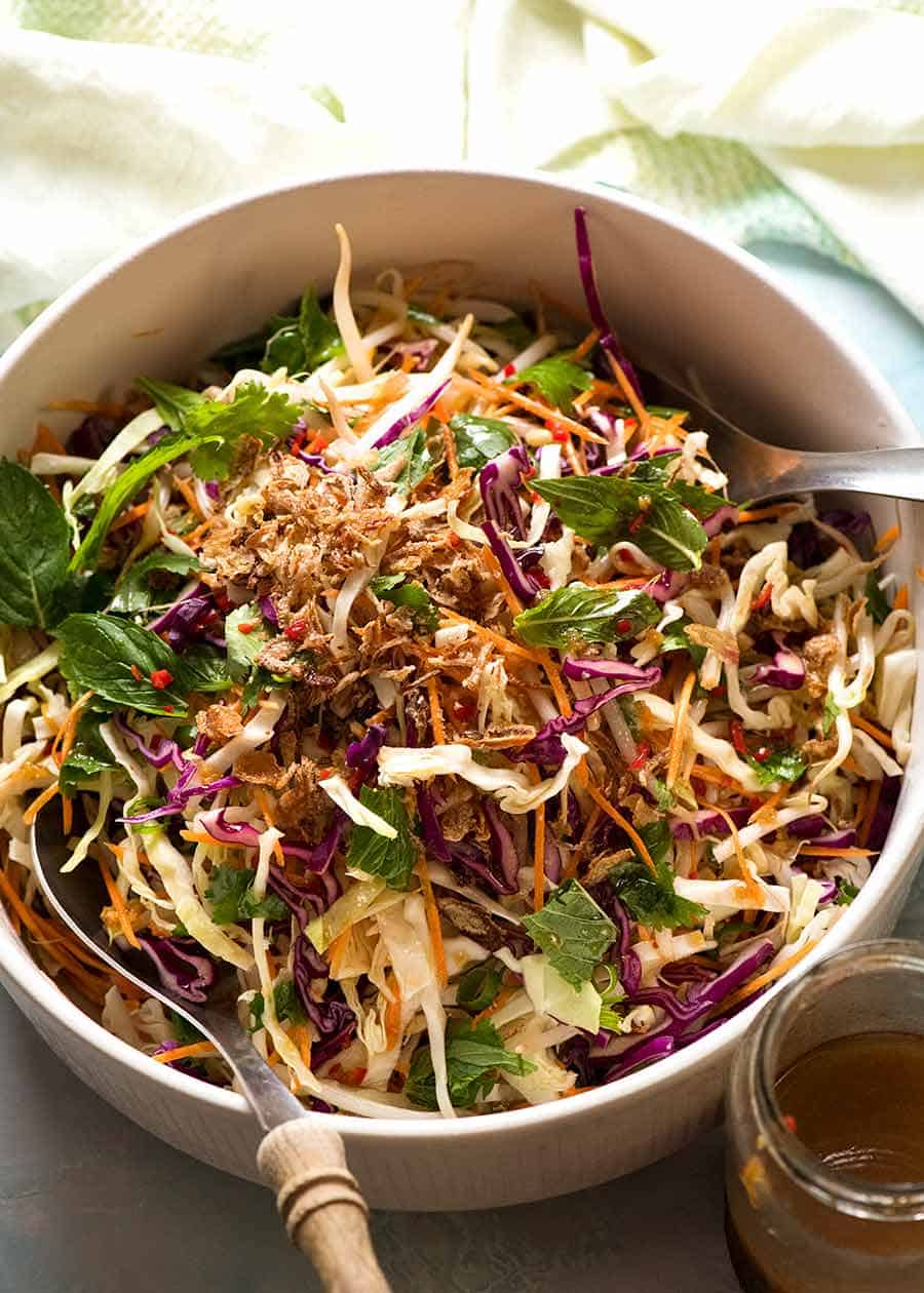 Asian Slaw in a salad bowl with Asian Dressing, ready to be served
