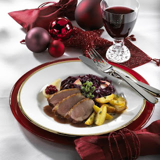 Roast Duck with Braised Cabbage and Crispy Potatoes.