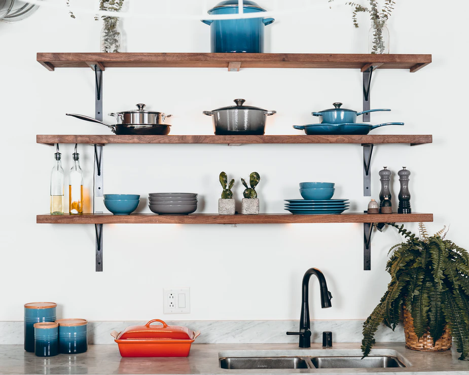 Open shelving above a kitchen sink