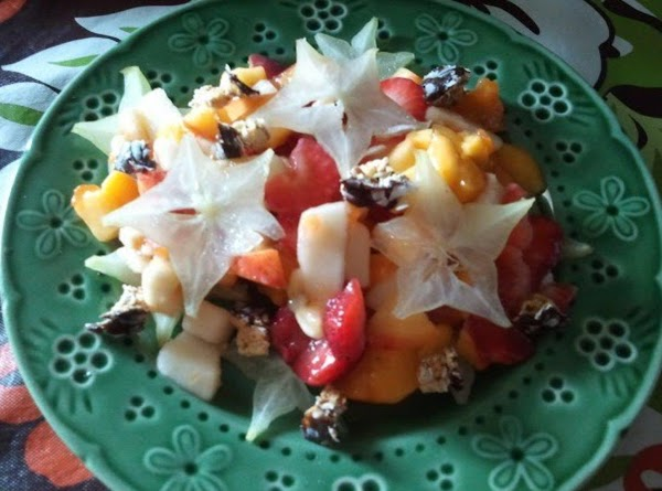 Scoop your fruit salad onto the starfruit bed.  Top it with some more...