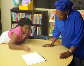 Photo: Kaleya explains how the check-out log will work
