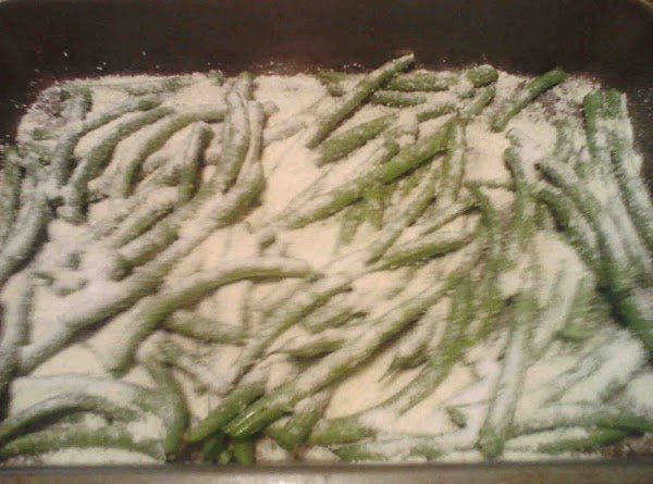 Cut and clean green beans. Drizzle with olive oil, garlic salt and pepper. Pour cup of...
