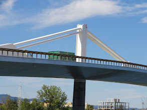 Photo: Lorry transporting rice to grain store crosses bridge