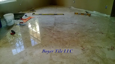 Photo: The process: Clean sub-floor, thinset for traction, mud-set material for height adjustment, thinset to tile. Repeat routine until surface is covered, properly.