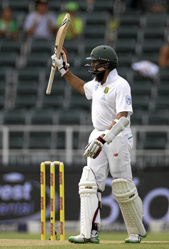 SA's Hashim Amla celebrates scoring a half-century on day one of the third Test against Sri Lanka, at the Wanderers on January 12 2017. Picture: REUTERS