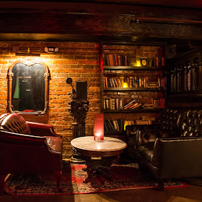 A Place to Relax by Thomas Shaw - Buildings & Architecture Other Interior ( art, north carolina, chair, nightlife, restaurant, picture, shelf, raleigh, bar, books, candle, place, table, lights, photography )
