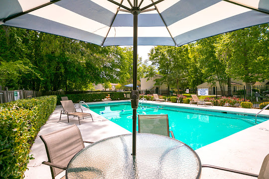 Apartment swimming pool with patio furniture on sundeck
