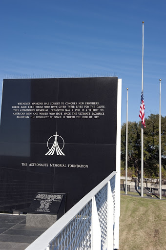 A flag flies at half-staff during a Day of Remembrance wreath laying ceremony to honor members of the NASA family.