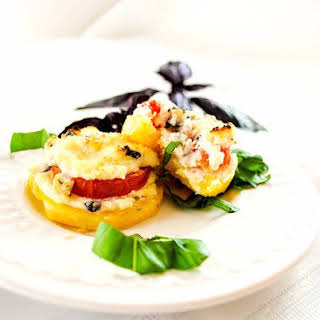 Cheesy Polenta Appetizer with Tomatoes, Ricotta and Basil.