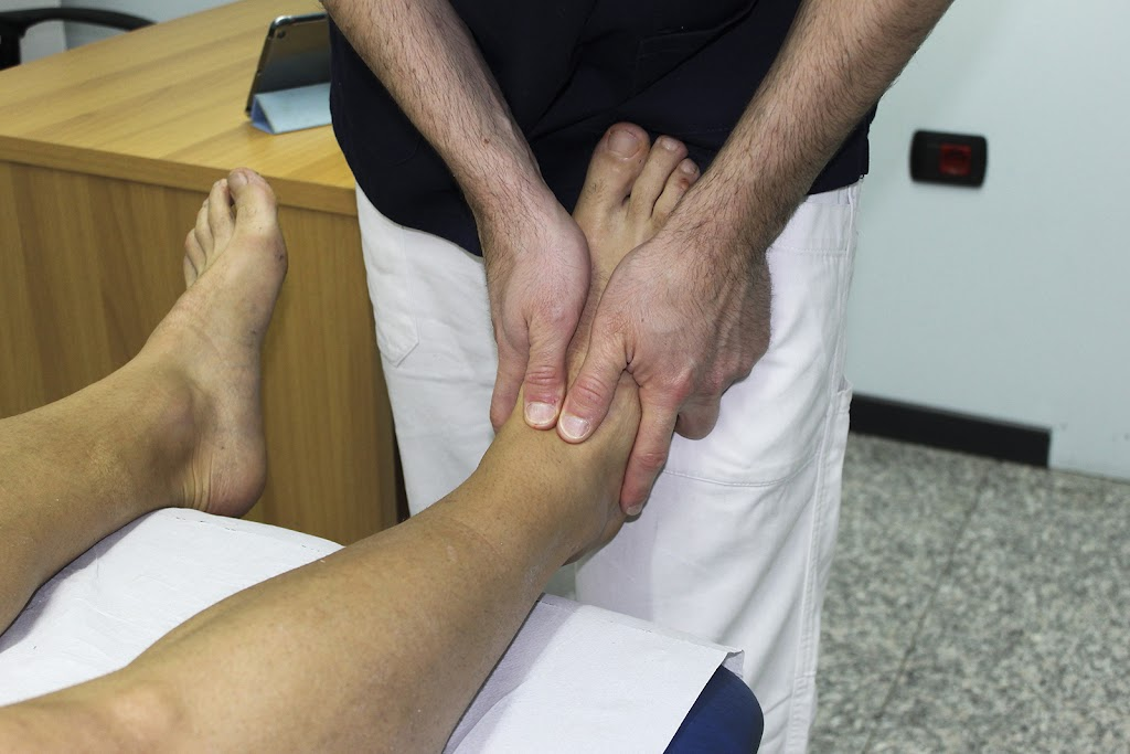 Physical therapist working on a patient's ankle