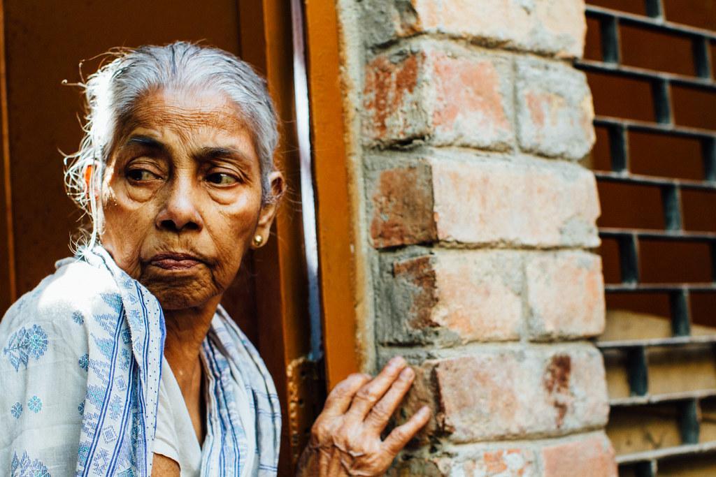 Elderly Woman Peeking Into Alley, Varanasi India | Adam Cohn | Flickr