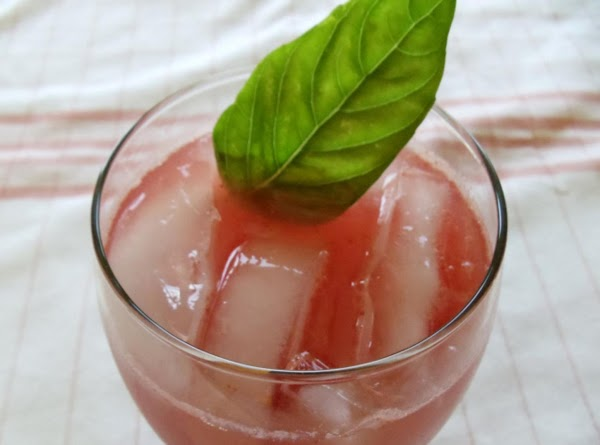 Garnish with fresh lemon slices and basil sprigs and serve!  VARIATION: Add about 8 ice...