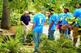 Photo: Sam Folwer, Director of the AU Water Resources Center, leads a tour on low impact development BMPs, such as rain gardens and rainwater harvest, in the AU arboretum.