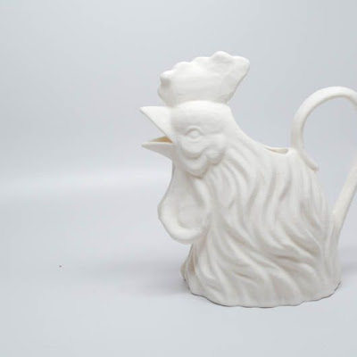 3d printing gallery image of a white jug that looks like a rooster with a handle on its back, made of white ABS Plastic
