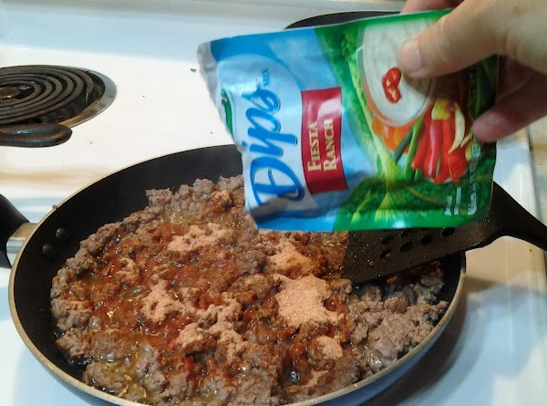 Add all but a tablespoon of the Fiesta Ranch dressing mix to the meat....