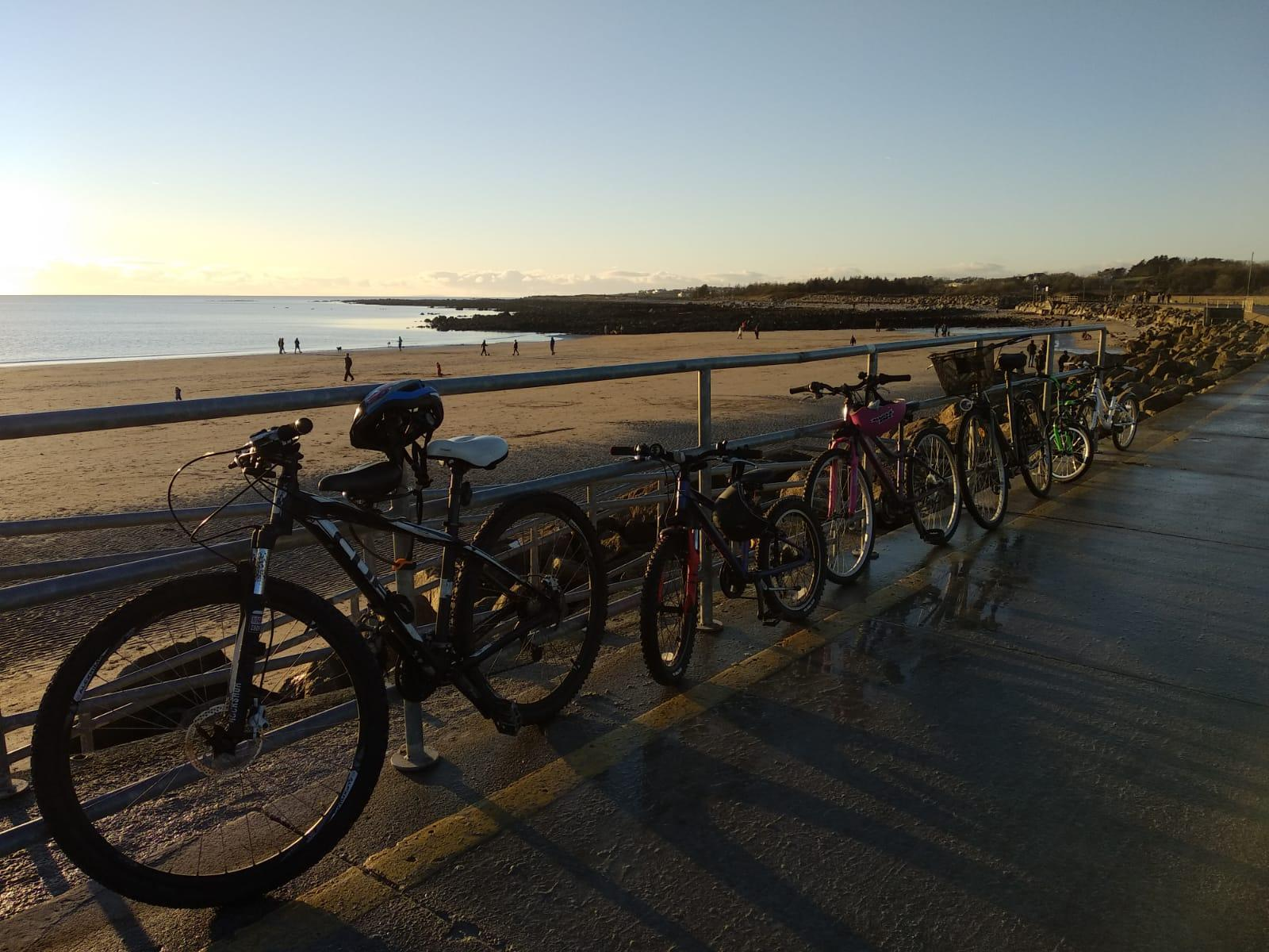 A picture containing sky, outdoor, bicycle, water  Description automatically generated