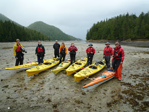Photo: A paddle up river at low tide meant we had to bring our kayaks in a fair ways on the beach.  Photo by Ben.