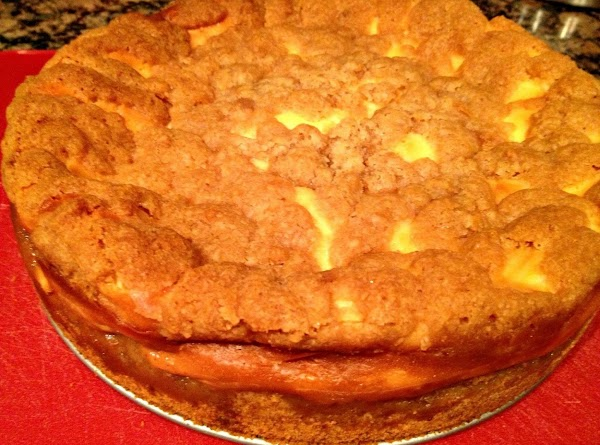 After cheesecake has baked 40 minutes, drop topping mixture over cheesecake. Put back in...