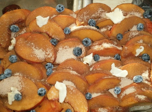 Preheat oven to 350' Pit washed peaches and slice into a large bowl.  (I...