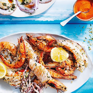 Grilled Seafood Platter With Romesco Sauce And Herb Crumbs.