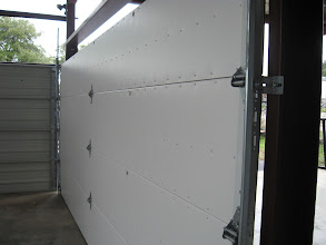 Photo: This is the back of a Wood Free Door. Note the steel back. Also note that it is an insulated door with a R6 insulation value. It also comes with a certificate from the manufacturer that certifies its qualification for the 2010 energy tax credit.