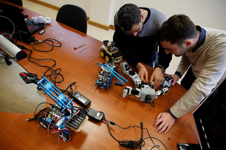 Research support officers and PhD students Luca Bondin and Foaad Haddad discuss an artificial intelligence project to train robots to autonomously carry out various tasks, at the Department of Artificial Intelligence in the Faculty of Information Communication Technology at the University of Malta in Msida, Malta February 8, 2019.
