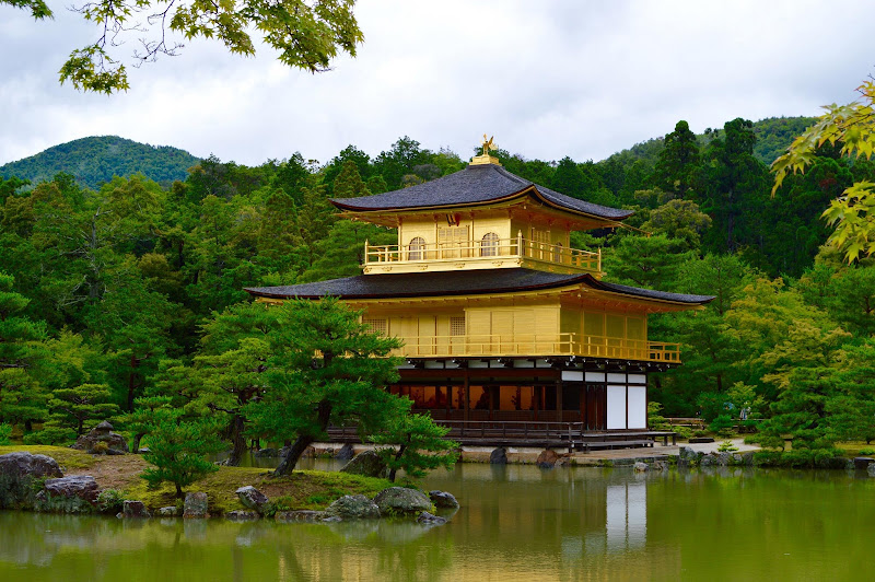 Golden Temple, Kyoto Kinkaku-ji, or the Temple of the Golden Pavilion, is a well-known Zen Buddhist temple that is mostly covered in gold leaf and is surrounded by a lush garden.