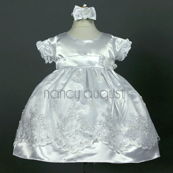 Photo: Baroque Princess Infant Dress in White: This elaborate and vintage-inspired infant dress is a sister to the rose-colored version, but with intricate sequins and beading on top of the embroidery! This white infant dress is made with shiny white satin and adorable short sleeves trimmed with a satin ruffle. The skirt features an overlay of crystal organza with an embroidered scalloped hem. The organza is decorated with ornate floral embroidery and covered with pearl bead and sparkling accents.