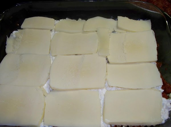 Top the cottage cheese layer with the slices of mozzarella cheese.