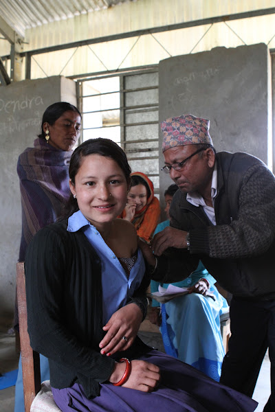 Photo: A girl receives her first-ever measles-rubella immunization at her school in Achham District, Nepal. The first measles-rubella vaccination campaign in Nepal aims to protect 10 million young people in 2012 alone. These campaigns combined with strong vaccination programs for infants can lead to the elimination of both measles and rubella.   Photo credit: Measles and Rubella Initiative/Christine McNab