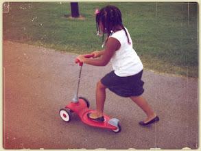 Photo: Kaleya rides her scooter - 8/10/11