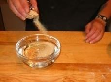 In a small bowl, sprinkle the yeast on the warm water and stir to...