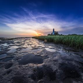 Lighthouse Sunset by John Smith - Landscapes Sunsets & Sunrises ( clouds, grass, lighthouse )