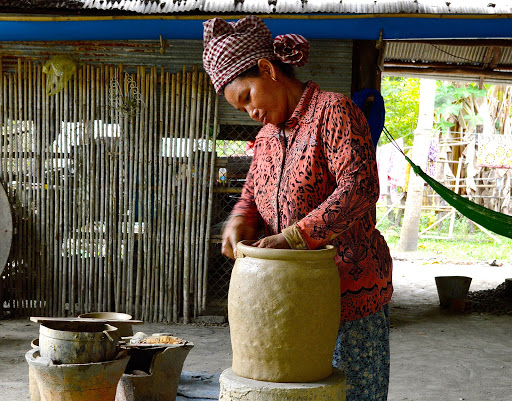 A woman making pottery in Vietnam. Locals have been crafting earthenware like this for thousands of years.