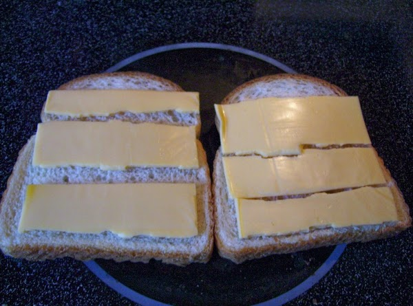 Take your bread, top with a slice of cheese broken into strips,  Now, lay...