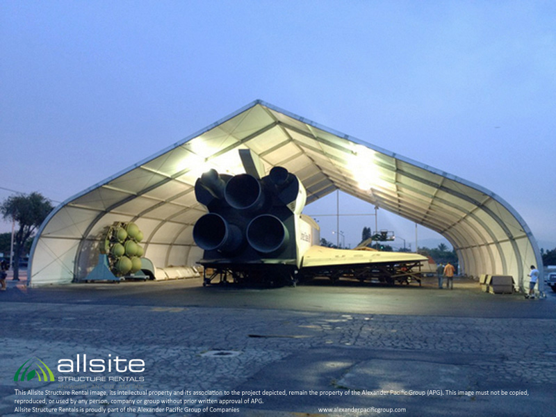 Space shuttle parked in an Allsite Structures open frame fabric aircraft hangar