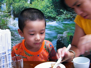 Photo: baby son, warrenzh, 朱楚甲, and his mom, emakingir, in restaurant.