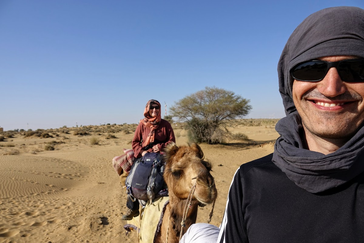 India. Rajasthan Thar Desert Camel Trek. Afternoon ride under the hot sun