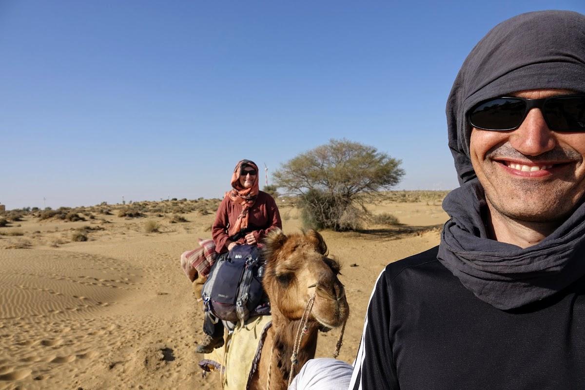 India. Rajasthan Thar Desert Camel Trek. Afternoon ride under the hot sun