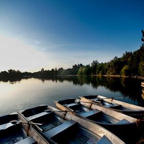 Boats and lagoon by Cristobal Garciaferro Rubio - Transportation Boats ( water, lagoon, boats, trees, sunrise, laguna de san baltasar, boat )