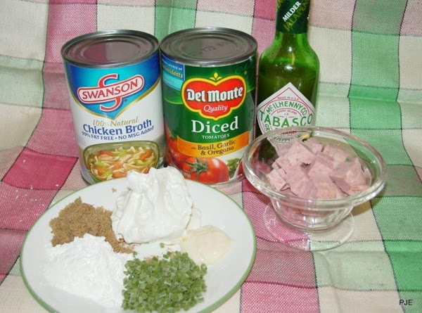 Put everything except the sour cream in a large microwaveable bowl, stir well and...