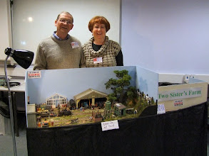 Photo: 018 Peter and Judi Marshall with Two Sisters Farm, an agricultural scene in 1:32 scale featuring Peter's collection of scratchbuilt and very quirky locomotives.