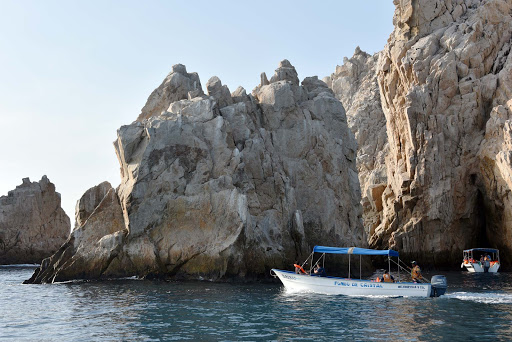 pleasure-boat-heads-to-los-arcos.jpg - Rock formations in the bay in Cabo San Lucas.