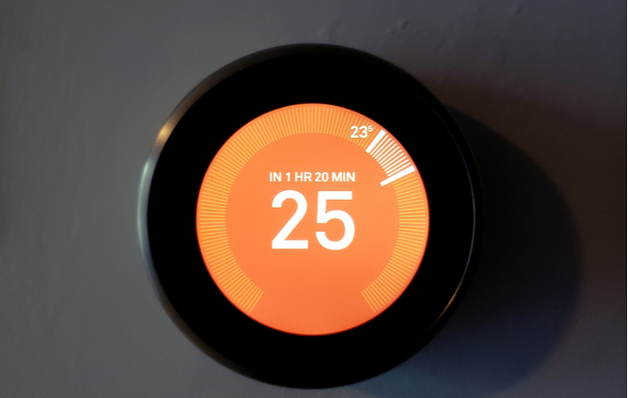 a smart home thermostat showing the temperature is 25 degrees