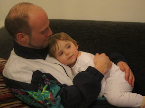 Photo: Cosy with daddy at about 10pm.
